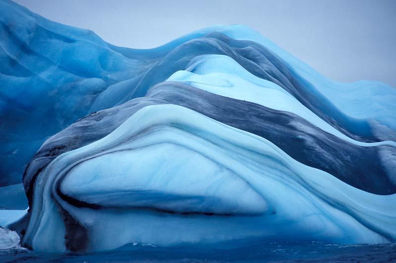 Cool blue antarctic iceberg