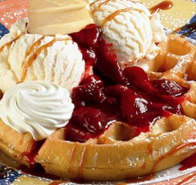 Waffle with cream, ice cream and raspberry sorbet