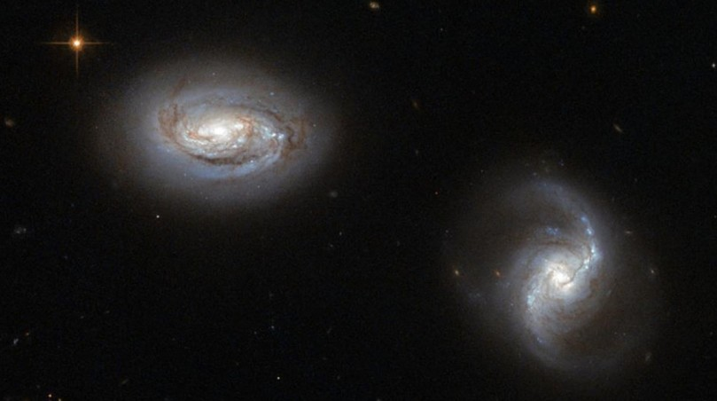 Two galaxies MRK 1034